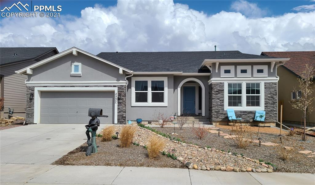 This beautiful 6 bedroom, 3 bathroom Classic home has way too many upgrades to list! Enter from the fully landscaped front yard with covered porch into the foyer with a bedroom on each side of the hall and a bathroom that has been upgraded from a tub/shower to a large free standing shower with built in seat and lovely tile work. The bedroom on the right side is currently being used as an office. Follow the wood floors through to a nice sitting area which could easily be used as your formal dining room with an opening into the kitchen with a nook area for use as a cocktail/coffee bar. You'll love this gourmet chef kitchen that has been completely upgraded. The kitchen features upgraded staggered cabinetry, stainless steal appliances with oven and microwave built in to the wall, gas stove, granite counter tops and large granite island with a stylish black sink. The eat in kitchen walks out to a covered patio with fireplace to relax on after a hard days work or to enjoy your morning coffee. Back inside is the other side of the 2 way fireplace in the living room. The large owners suite is right off the living room and also has it's own walk out to the backyard. The main bedroom has an en suite bathroom with a free standing shower with decorative tile, over sized tub, upgraded double sinks and a large walk in closet. From this bathroom you enter the laundry room. How convenient is that? Continuing through the laundry room you have the 2 car garage to the right with a cute mud area where you can hang your coat and store school/work items. Downstairs you'll find a large family room with a built in kitchenette, three other bedrooms with walk in closets, a full bathroom and an unfinished storage area with a wash basin. This storage area is the size of a single car garage space.  There is a park right at the end of the street and this home is located near the new super King Soopers, other shopping, and the Powers corridor.  This home has it all! See it before it's gone!
