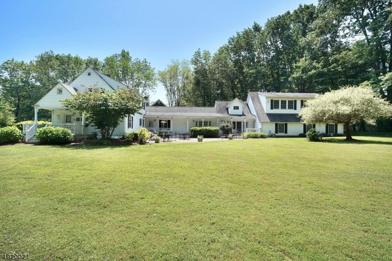 This unique home with so much to offer is situated on 2+acr in a cul de sac in walking dist to Mendham HS & town. The expanded floor plan offers original house w/ 3 bdrms & bath on 2nd floor plus living rm, dining room, well equipped kit w/ breakfast nook, den, covered side porch, & a basement great for storage. An addition in 1980's expanded the first flr to include a FIRST flr master suite w/ French drs overlking pretty views of the property. For entertaining, a fab entertaining rm/guest suite w/ full bath was added in 2001 & has a separate entrance. Great for hosting large outdoor parties or an extra room for hobby or teens: take your pick! The  3 car garage was also added then & offers a 700 sq ft office  w/ powder rm above; perfect if you work from home. A true gem in n historic town!