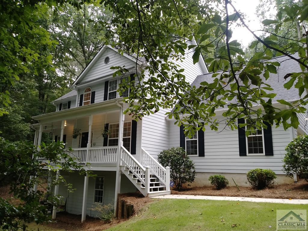 Lovely large custom Betz plan traditional home on over 1 acre wooded lot in Oconee. Near UGA, olde town Watkinsville, shopping, schools and all amenities. The house has new carpeting and LVP upstairs, nearly new HVAC (2 units) and roof 7 years old. Upgrades in the kitchen include granite counters. Stainless appliances, hardwood floors (50%) on the main floor. Two additional rooms upstairs, one used as an office and one used as a bonus room (over the garage). There is a full daylight basement stubbed for a bath and future expansion. Boat door in basement. Added attic insulation recently.  Both garage and boat door are insulated and the garage floor has been epoxy sealed.