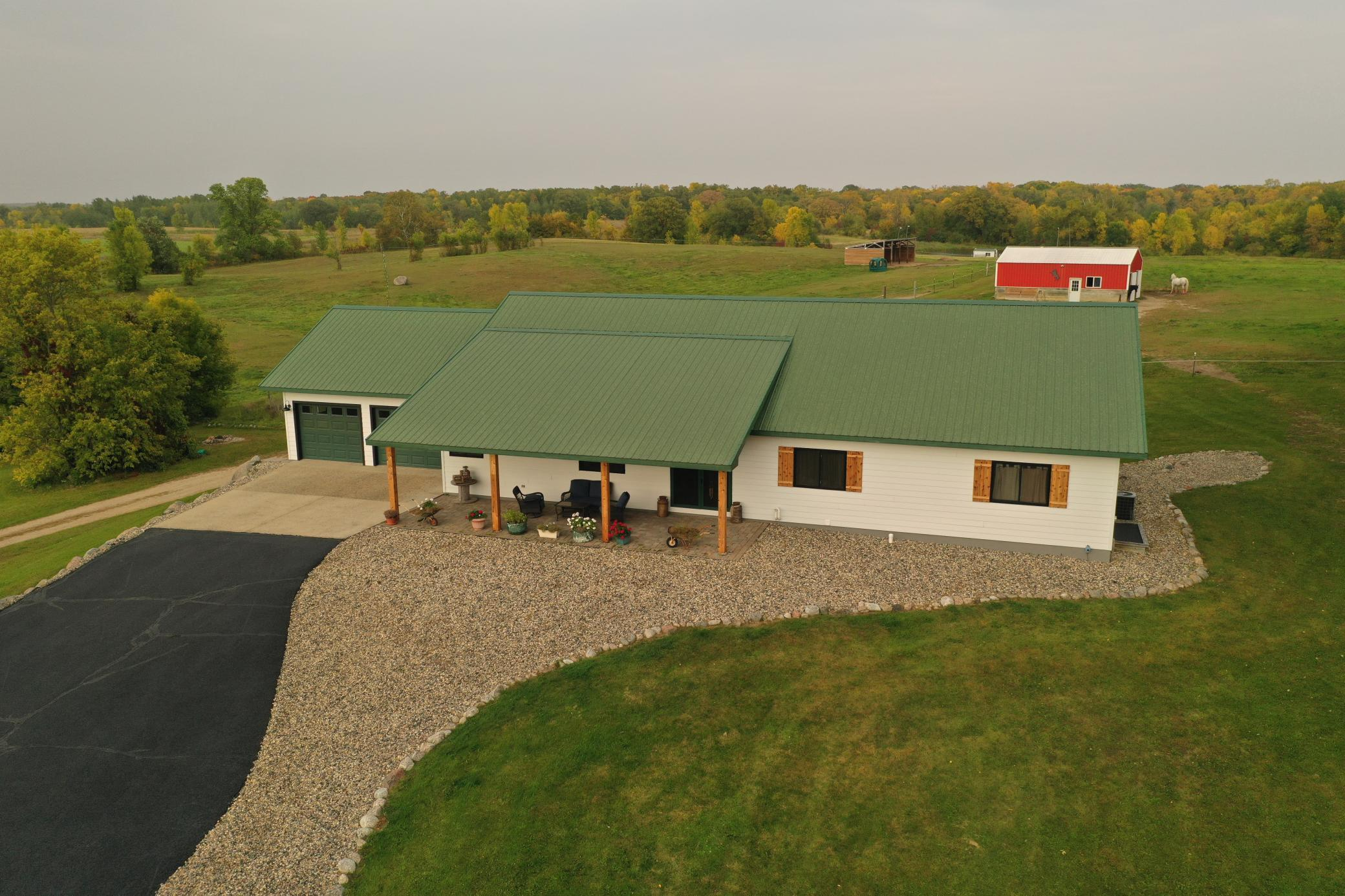 Country living meets LUXURY!! This gorgeous hobby farm property is situated in the midst of lake country just north of Alexandria! Open-concept 5 BR, 4 BA home with a mother-in-law suite and 2-attached garages, 2017 indoor arena, 2-stall barn with hay storage, heated shop with office, tackroom, and 3/4 bathroom, 3 lean-to shelters, 2 outdoor arenas, roundpen, and warming house next to the lighted pond. We also can't forget about the trails through the backwoods with deer cams scattered throughout! This home has new LP SmartSide siding and windows as of 2020 and a freshly sealed asphalt driveway. This is the ideal property for horse lovers, a bed and breakfast, or to operate your business out of! Absolutely gorgeous setting and must-see property! See supplement for more details!