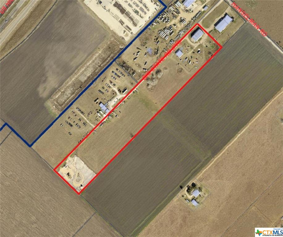 11.92 acres of commercial land perfect for an RV park, or storage facility. Property has 1 metal building and one storage building.