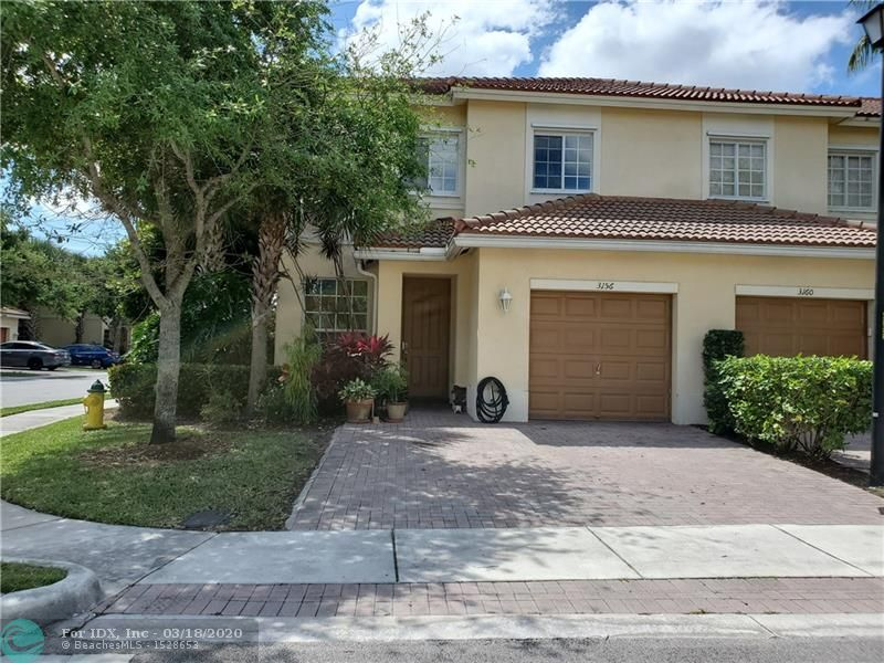 This fantastic townhouse was built in 2011 & is located in a terrific gated community. This modern townhouse is a corner unit w/ extra windows making this home light & bright! A true South Florida beauty with an open kitchen that overlooks the dining area. The kitchen features rich wood cabinets, granite countertops and stainless steel appliances. The first floor features a guest half bath and formal living area. The garage is large enough for storage and a car/SUV. The stairs have new updated laminate wood flooring. The 2nd floor features spacious bedrooms and modern baths. The master bath features dual sinks and a glass enclosed shower. There is plenty of parking and this wonderful community is great to stroll around the lakes and enjoy the sparkling pool! See it today, you will love it!