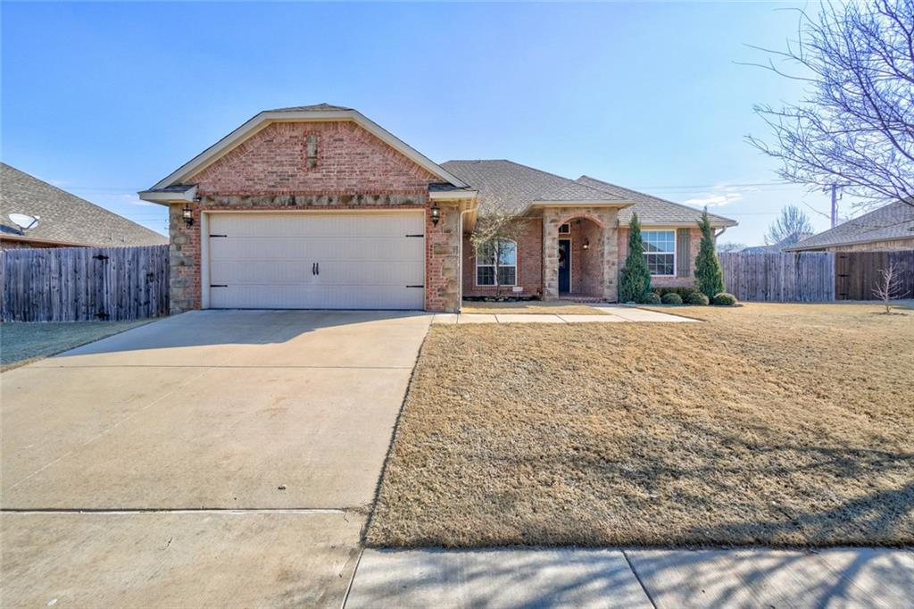 What an adorable, well cared for home located in Wimberley Estates! The front of the home is adorned with rock surrounding the porch and the walkway. Step through the welcoming blue front door and enter the foyer with stunning hardwood floors that flow throughout the study and living room area. This home is exploding with charm from the lovely stone fireplace mantle to the unique lighting fixtures. The kitchen is beautiful with light brown stained cabinetry and stainless steel appliances. It is open to the living room and boasts an eat-in dining space. The master is large with high ceilings and the bathroom is just perfect. You will find a large walk-in closet, double sinks, large soaker tub, and separate shower. On the other side of the home there are two additional bedrooms that share a bathroom.  NEW CARPET throughout the home!! Outside is a spacious fully fenced backyard with a good sized patio. Enjoy the space with a fun area made for a fire pit. This home is a dream!