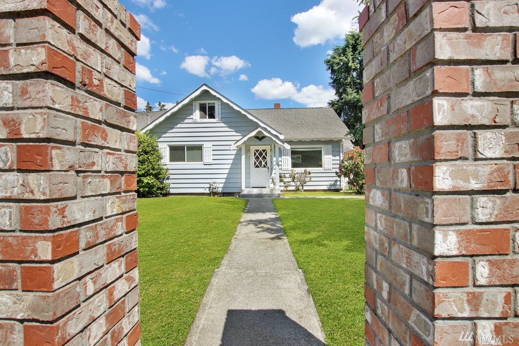 Charming from the moment you drive up w/ a wrought iron fence & flagpole. Spacious 4 bed, 1.5 bath home located in FSD w/ backyard POOL to enjoy! Interior features include wood floors, massive kitchen w/ large island & over sized living room w/ wet bar. All appliances stay. Expansive deck, pool w/ diving board, garden space, dog run & 2 car detached garage. RV parking w/ 220 service & sewer clean out. Corner lot & fully fenced. This would be the perfect home to update with your personal touches!