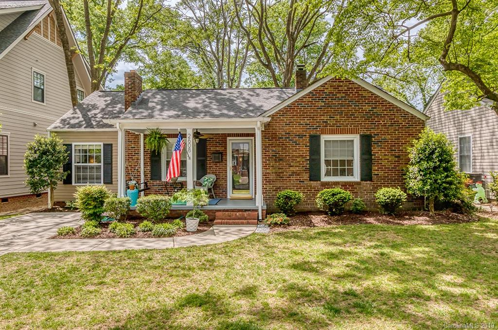 Adorable brick cottage tucked away in tree-lined Chantilly! Guests are welcomed by the covered, rocking chair front porch. Entry opens into the spacious living room with fireplace. The dining room is open to the kitchen and offers access to the back deck. Kitchen features maple cabinetry with glass front and custom shelving, black appliances, tile backsplash, hardwood floors and recessed lighting. Double doors lead to the master suite addition which features cathedral ceilings. Master bath with tile shower and beadboard. Original details such as glass crystal door knobs can be found throughout the home. Guest room with built-in window bench. Guest bath with tub/shower combo and beadboard. Large fenced-in backyard and deck are perfect for outdoor entertainment. Within walking distance to Plaza Midwood shops and restaurants. Just a short drive to Uptown Charlotte!