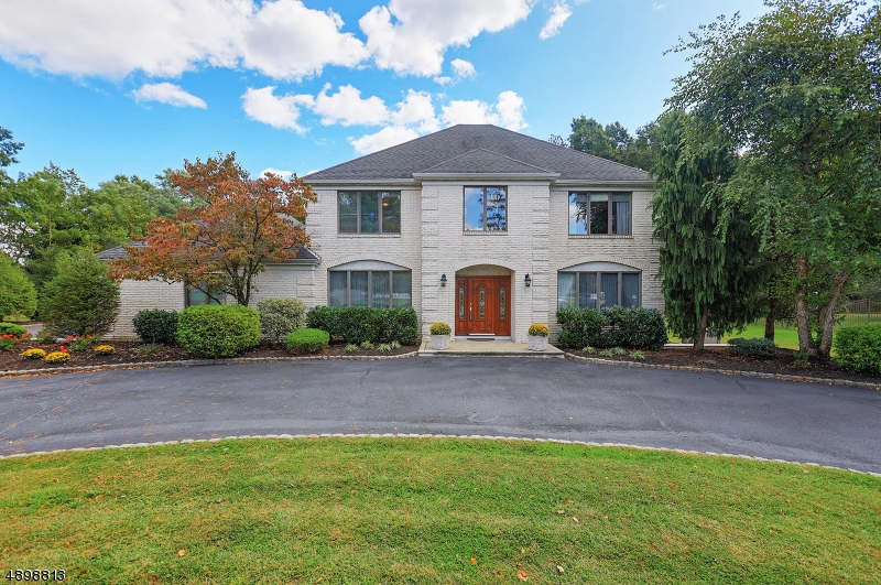 Spacious 5 BR, 3 Bath Colonial on cul de sac, 0.70 acres, recently updates inside and out. The highest quality features throughout, finished lower level, deck looking out on level property and woods Meticulously maintained, Privacy and convenience to all modes of transportation including train to NY. Full Home Generator .