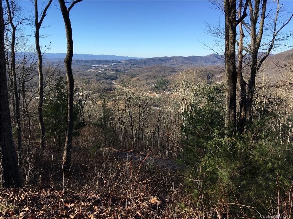 Top of the World! Spectacular views, overlooking Reynolds, E Asheville and beyond! Close up views of Cedar Mountain.  Approved for 4BR septic. 4 new homes in neighborhood. 1 1/2 mile hiking trails thru 88 acres w  picnic areas, water features, boulders, views, huge oaks & rhododendrons.  Only 19 homes allowed on Chestnut Mountain  from 2 to 7 acres each.  5 minutes to Asheville- 10 minutes to downtown. 2 miles to supermarkets, restaurants, bank, car wash, AC Reynolds Middle & High School.