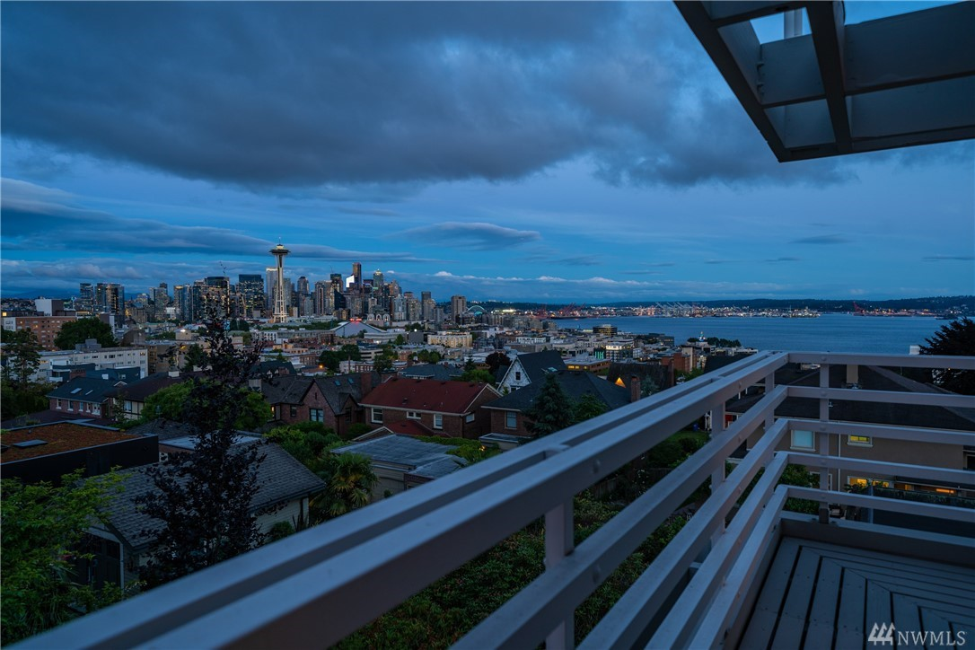 The most coveted block on Queen Anne; located in the heart of the South West slope with magnificent & unobstructed views of the Seattle skyline, Space Needle, Mount Rainier, and Puget Sound. This home is situated on a beautiful flat lot from street to paved alley. Three bedrooms up including a huge master bedroom. Updated kitchen with very large island, spacious formal dining room with fireplace and view deck are just a few features of this must-see home. Less than 10min to downtown Seattle.