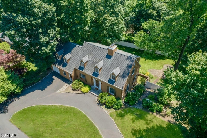 RARE VALUE IN OLD SHORT HILLS. SUPERB LOCATION WITHIN BLOCKS TO NYC TRAIN & TOP RATED GLENWOOD SCHOOL! BEAUTIFULLY UPDATED 4 BR, 3.5 BTHS IMMACULATE COLONIAL WITH SUN DRENCHED ROOMS & GLEAMING HARDWOOD FLOORS. FRONT TO BACK LR W/WOOD BURNING FIREPLACE. GOURMET KITCHEN, W/S.S. APPL. GRANITE COUNTERS & BREAKFAST BAR W/2ND SINK. OPEN TO DR & 1ST FLR FAMILY ROOM W/SLIDERS TO DECK. FENCED PARK-LIKE BACKYARD IDEAL FOR ENTERTAINING. 1ST FLR FULL BATH. 2ND FLR FEATURES STYLISH PRIMARY SUITE W/WIC, WOOD BURNING FIREPLACE, TUMBLED MARBLE SPA-LIKE BATH W/RADIANT FLOOR. 3 ADDITIONAL BR &  BTH. FINISHED W/O BSMT W/  REC ROOM, OFFICE, PDR RM AND LAUNDRY. OTHER FEATURES: CROWN MOLDING IN LR AND DR, NEW WINDOWS, RECESSED LIGHTS, CUSTOM CLOSETS, HUNTER DOUGLAS WINDOW TREATMENTS, NEW WATER SOFTENER, CIRCULAR DRIVEWAY