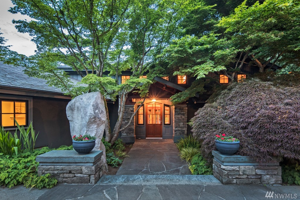 Masterpiece of tranquility, this Lawtonwood estate sits on a shy-acre at the edge of Discovery Park. Northwest architectural design incorporates a light-filled interior with a peaceful outdoor setting. Reclaimed wood ceilings and unique, hand-forged fixtures create a warm, relaxed atmosphere. Enjoy lush, heirloom gardens & historic pool in total privacy. Natural spring-fed waterfall flows by on the way to the Puget Sound. Incomparable property, a welcomed retreat from the hectic pace of the City