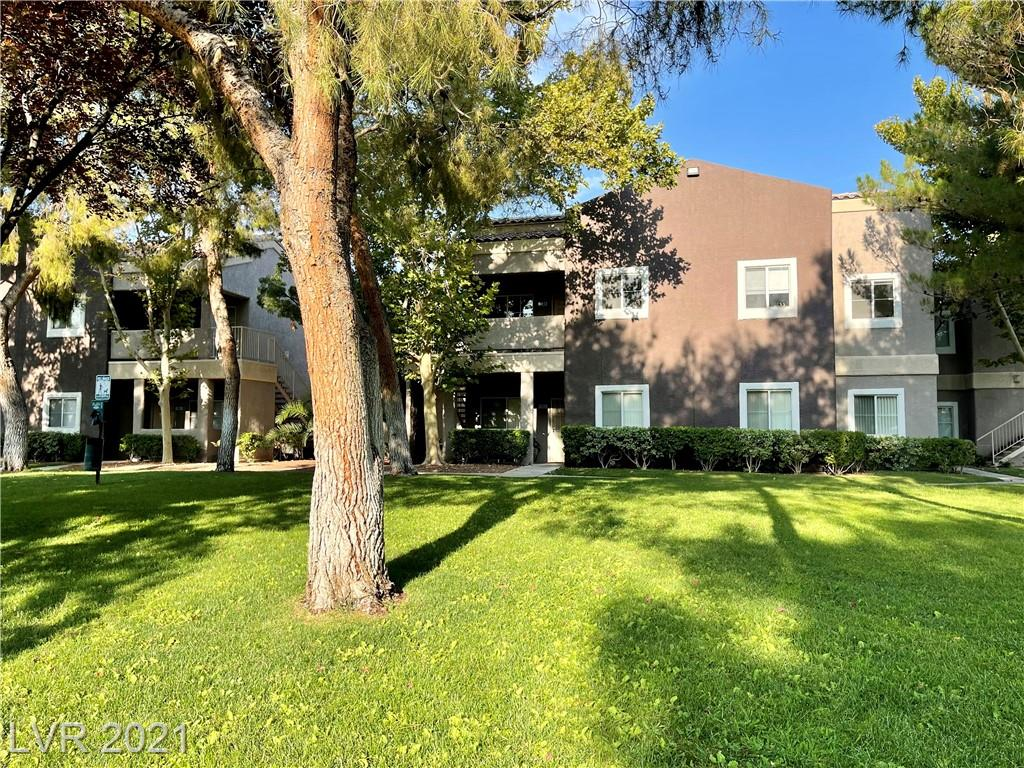 Immerse yourself in the green! This beautiful 3 beds, 2 baths condo, a rare one with a spacious attached two car garage, is looking straight at the community park. You can actually count 76 trees from the balcony! The property went under some major remodeling in 2018, with new bathrooms, kitchen, flooring and water heater. Refrigerator and microwave are still under warranty for another 7 years! Soft closing drawers in kitchen and both bathrooms, high ceilings, open space area, direct access to the garage. 24/7 guard gated luxury community, featuring gorgeous resort style pool with rock waterfall grotto, playground, dog area, mini golf, fitness center, a beautiful club house where you can host your parties, be sure to check out all the amenities!! Conveniently located in the heart of the valley, near the airport, the Strip and the new Raiders stadium. Spring Valley Hospital is literally next door! Lots of shops and restaurants around! You really have to come and see this one!