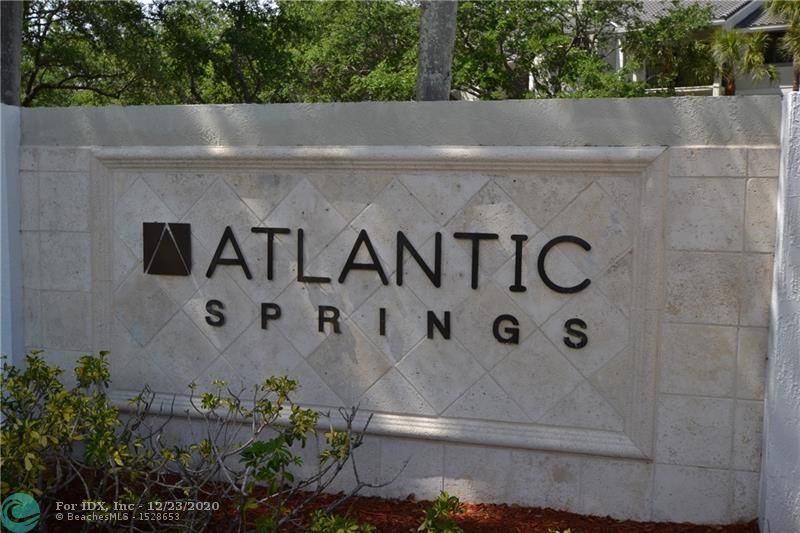 Super 3 bedroom 2 bath second floor condo in beautiful Atlantic Springs. Spacious living areas , updated kitchen with wood and granite, laminate flooring, formal dining area, lovely view from balcony.  Tons of closet space! Gated Resort style community with W/D in the unit, pool, spa, gym, tennis court, club house.Great for Investors (rent 1st year) or Homebuyer. Located in heart of Coral Springs close to shops, restaurants, hospital, schools and more.1 mile to highway for fast access north or south. 24 hr notice to show, has tenant (month to month)(NO SUNDAY SHOWINGS)