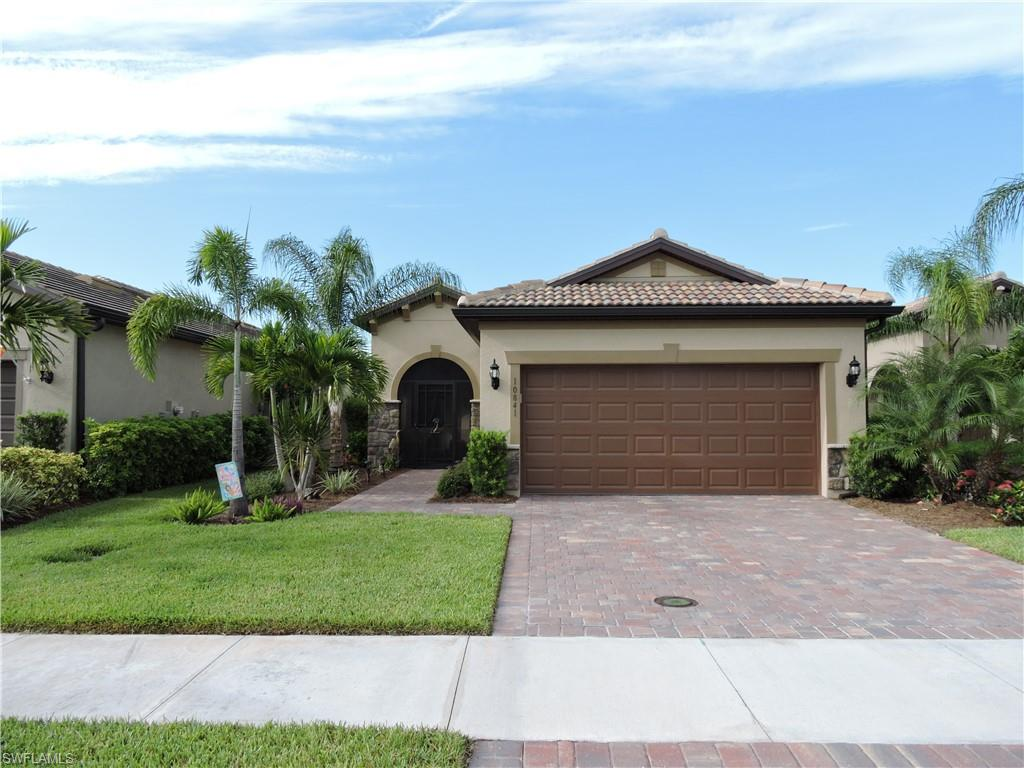 This beautiful PULTE home with an extended lanai and breathtaking saltwater pool located on a LAKE and PRESERVE view with plenty of privacy. IMPACT WINDOWS THROUGHOUT give you peace of mind in this 2bd/2ba home. The screened entrance gives cross ventilation for energy efficiency when the weather is nice. The kitchen has a large island for the cook in the family, granite countertops, large pantry and an open floor plan to see the beautiful views!  A picture window screened( no view blocking rail) pool has multi-colored LED lights, automatic refill (comforting for when you are away on vacation or up north) and a top of the line pool pump and heater. Master bath has a large tiled shower and a transom window to allow natural light. This move in ready home will go fast!! Bridgetown is an active community with a resort style pool, lap pool, hot tub, and high-end fitness center.  There is a lifestyle director who plans activities throughout the year. This community is conveniently to the airport, restaurants and shopping.