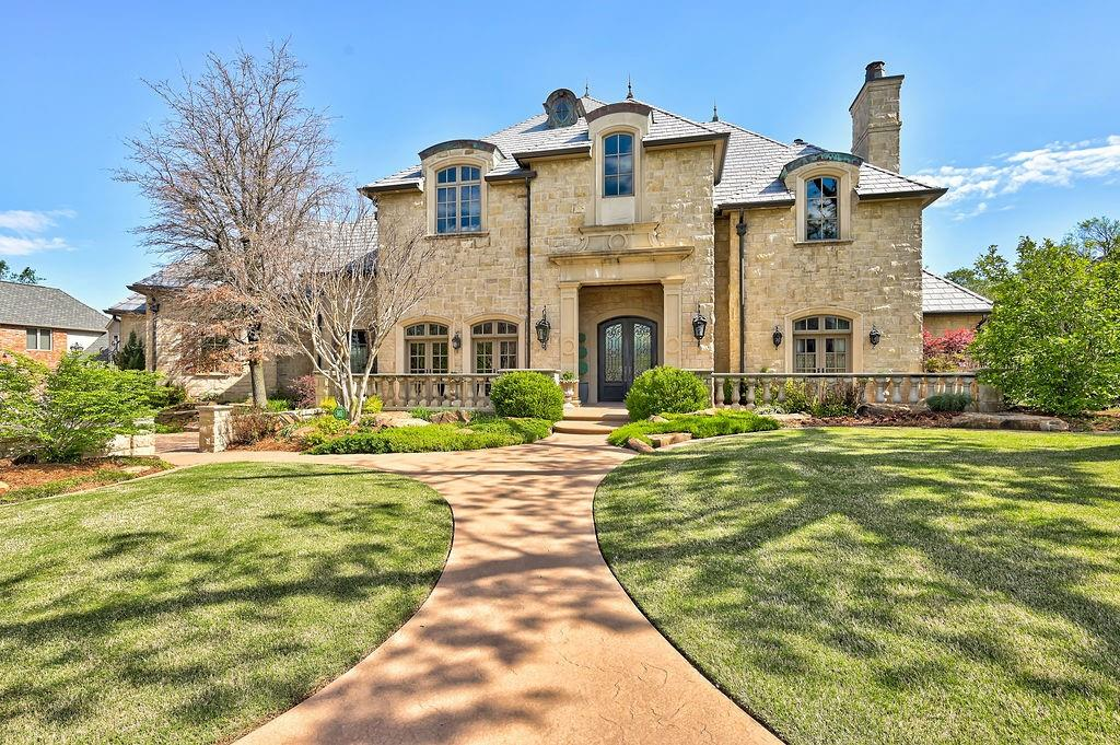 """Your dream home awaits you, right in the heart of Norman! This custom built home by Jim Bowers has 4 bedroom, 5 bathrooms, grand foyer, chef's kitchen, dining room, 2 offices, laundry room, upstairs bonus space, wine storage, plus so much more.  The master bedroom is located downstairs. An exquisite master bathroom features 2 large """"his & hers"""" closets, a juice bar area, including a mini refrigerator and also opens up to the backyard.  The gourmet kitchen, with a beautiful cast stone oven hood, is a dream- also featuring Wolfe appliances, subzero refrigerator, 2 dishwashers, 2 sinks, and a commercial size Hoshizaki """"Sonic"""" ice maker.  The kitchen and living room overlook the backyard entertaining oasis, featuring an outdoor kitchen, fireplace, beautiful pool and hot tub.  This stunning home also has a one of a kind 1950's diner!  The diner contains 2 built in booths, plus so many other special designs. It is one of a kind! If you are looking to entertain, then look no further!"""