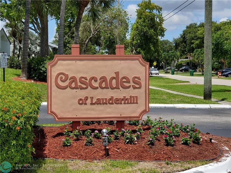 Nicely located unit in the Cascades of Lauderhill. 1 Bedroom plus a Den with 2 Full Baths (Den can also be used as 2nd bedrrom or office). Relaxing lake views from Living Room, Master Bedroom, and Den. Full size Washer/Dryer in unit. Property is being sold As-Is. EASY TO SHOW AND PRICED TO SELL!