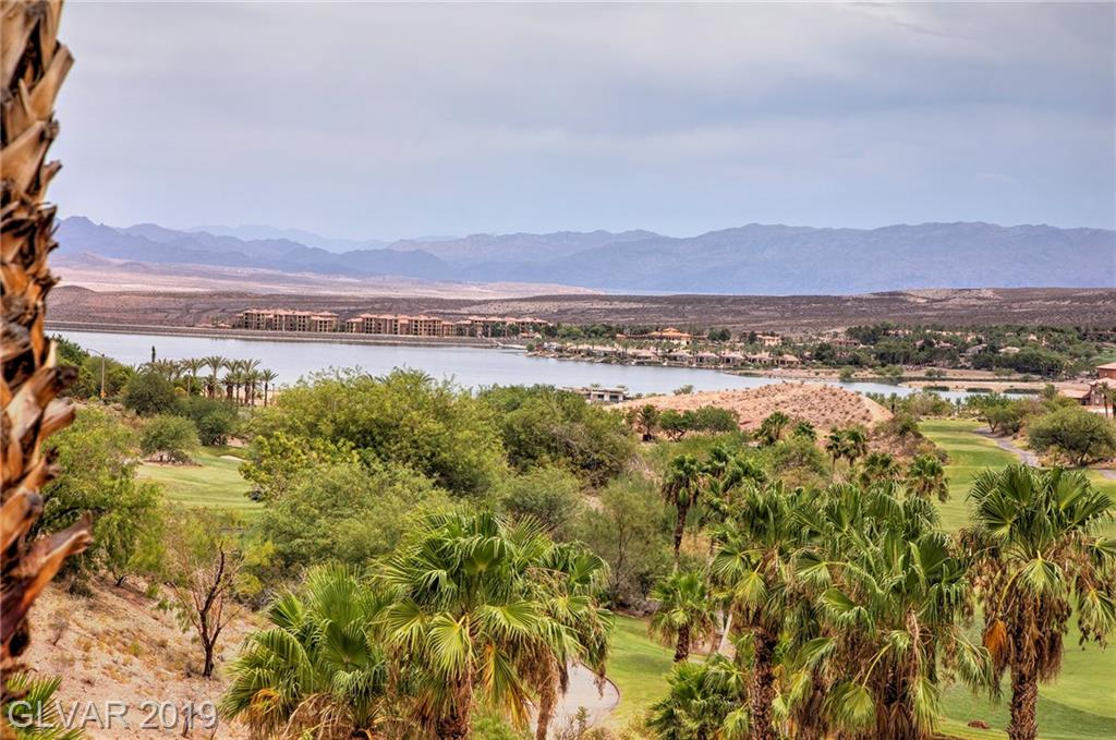 Impeccable unit with spectacular views of the lake and golf course.  Swimming Pool is right off the terrace.  This unit has never been rented out and is in excellent condition.  Some furniture may be available outside of escrow. Excellent amenities include 3 pools, spa, clubhouse, boutique gymnasium, games room BBQ. Community features public golf course and Sports Club, Convenience Store and Restaurants in the Montelago Village.