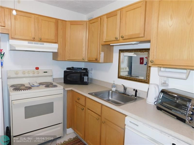First floor unit in gated community. Tile flooring throughout, newer AC, very spacious bedroom with a lot of closet space. Active community with pool, tennis, shuffleboard and BBQ.  Close to transportation and shopping.