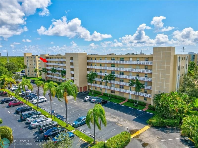 LOCATION, LOCATION, LOCATION - Highly Desirable End/Corner Unit on 5th Floor! Beautiful Lake Views - Building has reserves & you can buy with 5% down. Condo living with a home feeling. Unit is on 5th floor with parking space right in front for easy and convenient access perfect for an active lifestyle. Great location east of US 1 only 2 miles from Hollywood Beach/Boardwalk and Dania Beach. Needs some Updating -This unit is open and bright with sunny south view Florida room over looking the Meadowbrook lake/fountain perfect place to relax in this zen environment. Well maintained with newer A/C -  Community of all ages, heated pool, clubhouse and sauna. Pets Okay w/Association Approval - Less than 1 mile to the Beach!