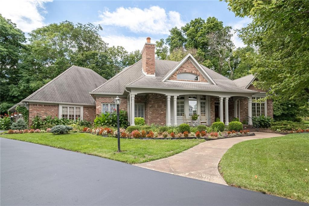 """Gorgeous woodwork & design showcase this one of a kind custom brick ranch on a tree lined cul de sac lot featuring 4 generous bedrooms, 4 full baths & basement. This home is for the discerning buyer who appreciates quality of construction & detail including: full brick wrap, transoms, fluted case openings, 10' ceilings, 4 1/4"""" crown molding, 3 1/4"""" base trim, pocket doors, built in cabinetry, bay windows, tray ceilings, arched openings, solid wood doors, 3 gas fireplaces & an abundance of closets. From peaceful morning routines to lively entertaining, the inviting Kitchen, Hearth Rm & Screened Porch create the perfect layout of natural light & colorful blooms. Award winning Carmel Schools. Conveniently close to shopping, dining and parks."""
