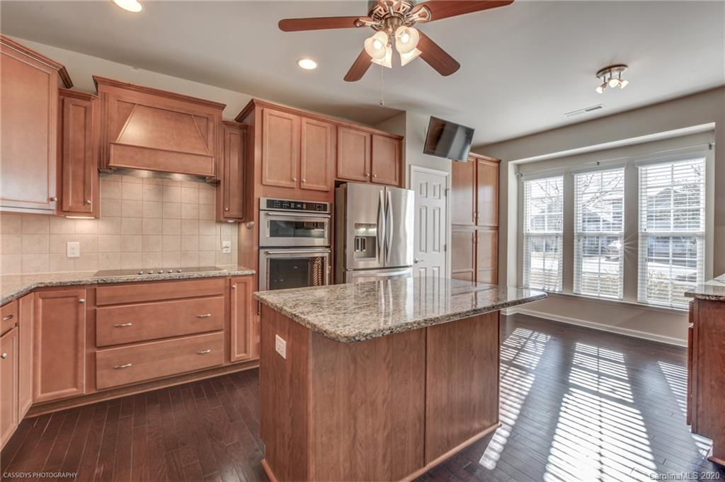 """Meticulously maintained & move in ready! 1.5 story w/ 3 bedrooms on main + loft, bedroom & full bath upstairs. Larger Willow Bend floorplan built in 2015. Private location backing up to wooded common space close to Catawba River. Kitchen features 36"""" electric cooktop, vent hood, KitchenAid SST interior dishwasher, built-in micro/convection & wall oven, french dr fridge, beverage fridge, pantry + cabinet pantry w/roll-outs, u/c lighting, granite, work island, ceramic b/s & more!Master features 5' walk in shower w/ grab bar, add'l cabinetry, dual vanities, Closets by Design walk in closet. Hardwoods on main, 2"""" faux wood blinds, recessed cans thru-out. Laundry w/ utility sink, cabinets & drying rack. Secondary brs have hardwood & secluded from master.Lennox HVAC w/  transferable warranty to 2025. Oversize garage w/ shelving. Amenity rich 55+ Sun City features golf course,3 pools,indoor pool,tennis,ballroom,pottery studio,indoor track,fishing,kayaking,softball & golf cart access & more!"""