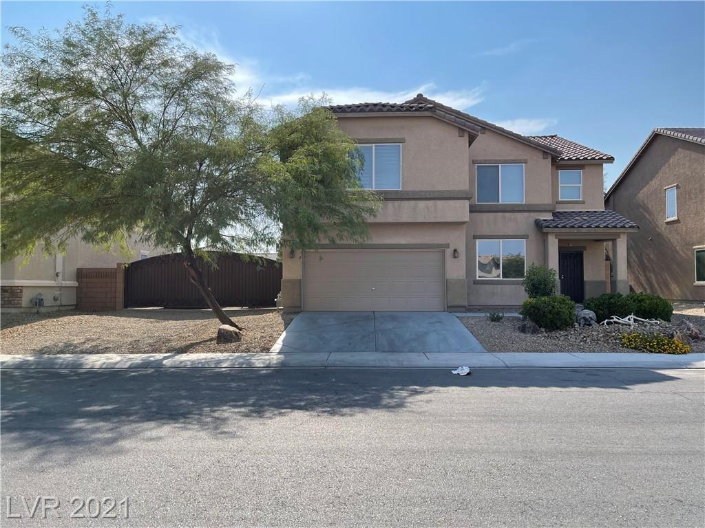 GORGEOUS HOME!!! FEATURING 4 BEDROOMS, 3 BATHS, AMPLE LIVING ROOM, GORGEOUS KITCHEN WITH STAINLESS STEEL APPLIANCES, GRANITE COUNTER TOPS, CUSTOM CABINETS, KITCHEN ISLAND, AMPLE LIVING ROOM, HUGE MASTER BEDROOM, HUGE SECOND BEDROOM, MOUNTAINS VIEWS, GATED RV PARKING WITH SEPARATE RV SEWER SYSTEM, DESERT LANDSCAPE, ROCKS, MATURE LANDSCAPING IN BACK YARD!!! THIS ONE WILL NOT LAST!!!