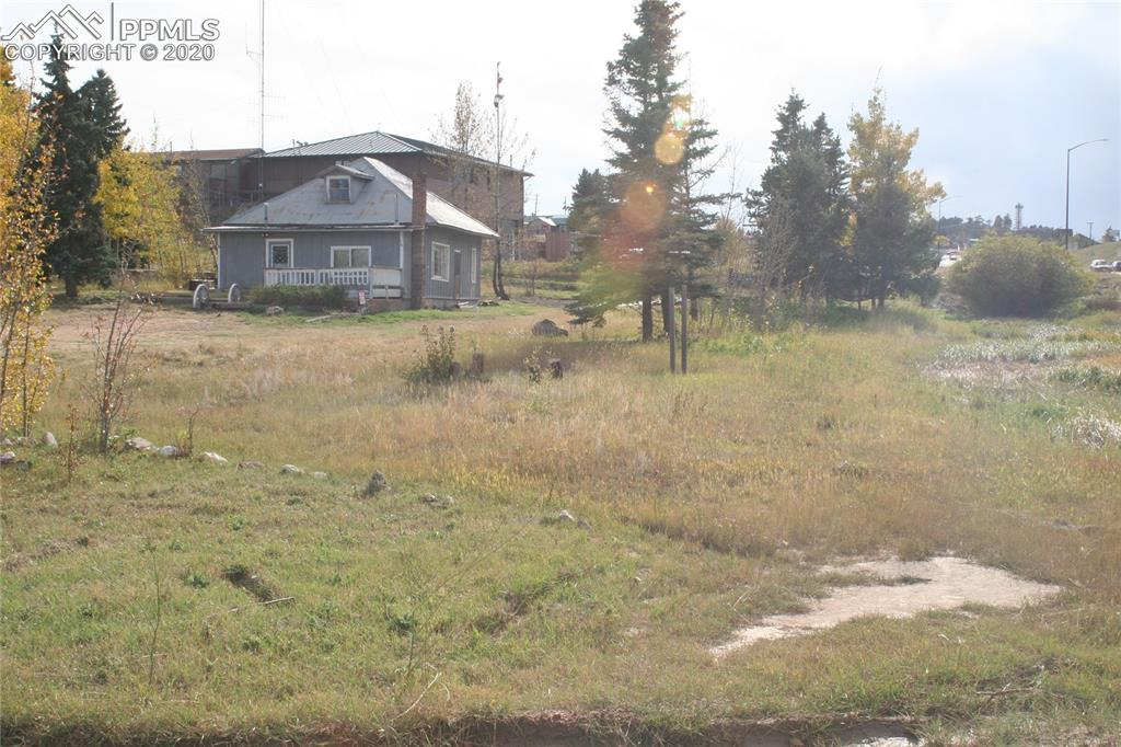 1.26 acres fronting Hwy 24 adjacent to the Teller Co Sheriff's office in Divide, CO Community water available. existing sewer tap and electricity. High traffic area. Zoned A-1