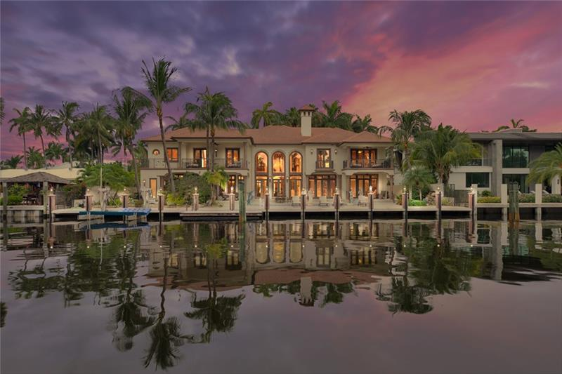 Spectacular estate encompassing nearly 8,000 sq. ft. 120' of DEEP WATER dockage on wide canal, boat lift, tiled concrete dock. Las Olas' best isle & waterway, underground utilities. Impeccable craftsmanship - Venetian Plaster, custom paint/moldings, gold leaf accents, coffered ceilings, inlaid marble floors. Stately 2 story fireplace in living room w/floor to ceiling windows. Exquisite chandeliers & frescoes/custom lighting and vaulted ceilings throughout. Beautiful master w/ His & Her baths/closets plus enormous bonus closet off master, oversized terrace and balcony. VIP guest suites w/ balconies. Expansive fully equipped chef's kitchen. 3 car garage, office, custom pool w/ spa, backyard garden and pond. This unique offering is pristine in every way & a pleasure to show!