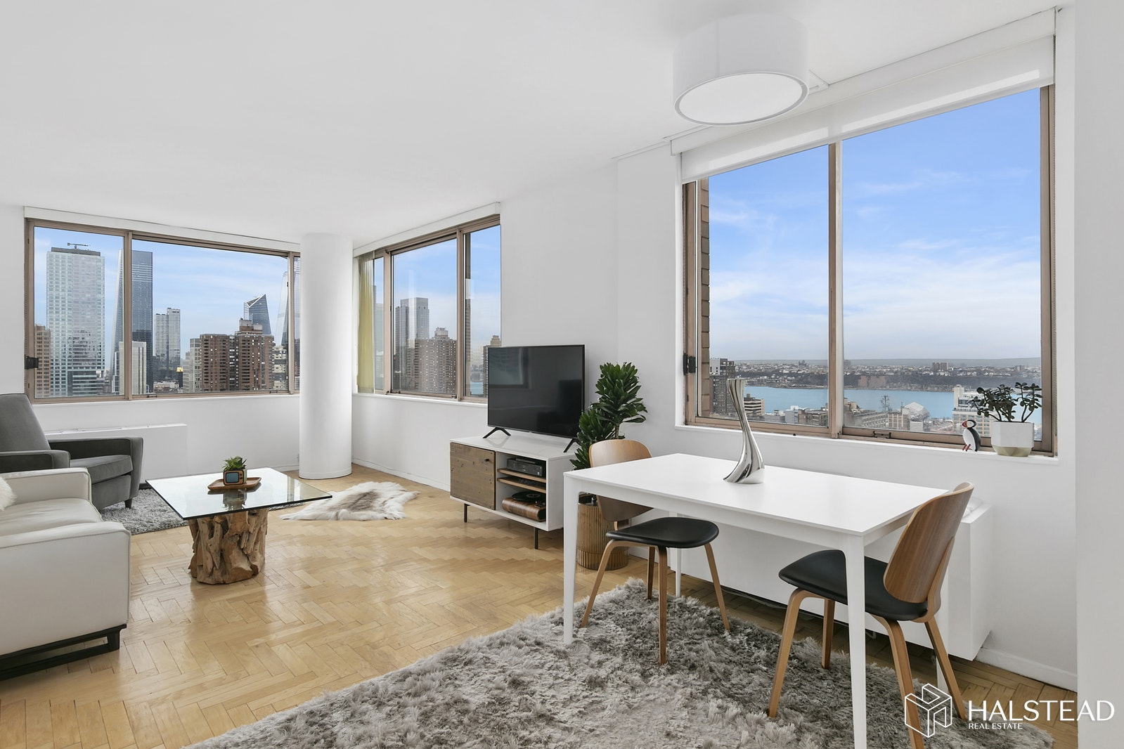 Open House By Appointment Only - June 28 from 2pm-3pm. Please inquire within to confirm your appointment.Views, sun and light. You can bet on all three in this high floor corner split two bedroom with wide open views to the south and west featuring Hudson Yards and the Hudson River. The pass-through renovated kitchen sets the high floor E line apart starting on the 32nd floor with the most efficient layout (lower E line floors have a different layout with galley kitchens situated at entrance). The sleek and smart kitchen design boasts white cabinetry extended to the ceiling for additional storage, stainless steel appliances and pantry. The grand living room provides the perfect backdrop to savor the views with a practical feel to accommodate your natural living area and separate dining area plus a wall of built-in closets. The king size master bedroom presents river views from bed, a practical sitting area or home office and large walk-in closet. The en suite marble master bathroom has been updated with lively colors and can be easily customized to your taste. The second bedroom offers ideal privacy with stunning southern views adjacent to the second bathroom outfitted with washer/dryer. Pet-friendly Worldwide Plaza is a full-service condominium with a plethora of amenities including the full-time doormen, live-in resident manager, private courtyard, multiple laundry rooms, onsite Elite New York Sports Club (25-meter saltwater pool, metabolic studio, and custom juice bar), onsite parking garage and private storage. Idyllic Midtown West location near Central Park, Hudson River Greenway, the theater district, Lincoln Center, Rockefeller Center and unlimited dining and shopping options. Convenient public transportation options include the C, E, 1, W, N, R, B, D, F and M subway lines and cross-town buses. Pied-a-terres and investors welcome. Real estate taxes displayed may be reduced by 17.5% if purchasing as your primary residence (Consult your CPA).
