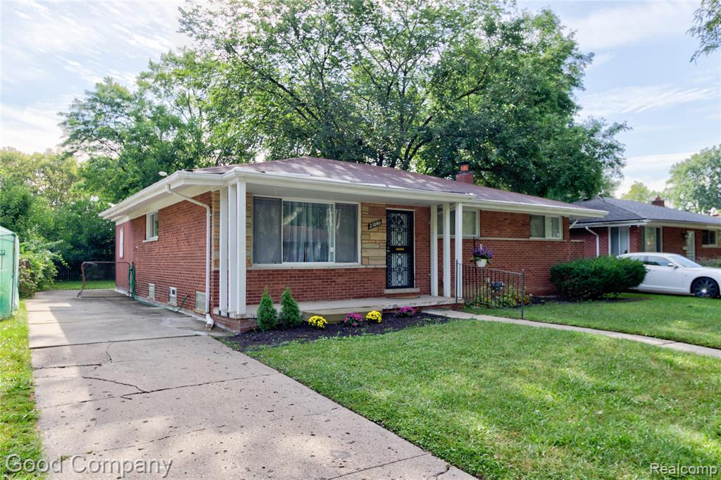 Fantastic brick ranch in Oak Park features a lovely interior with beautiful hardwood floors, roomy kitchen, finished basement, and private backyard. Bright open living room and dining room with coved ceilings and built-in shelving. Spacious kitchen with custom backsplash and ample cabinet space. Enclosed back porch off the kitchen. Three nice sized bedrooms share a full bath with separate second vanity and custom tile. Large finished basement with a second full bath, laundry, bar, and plenty of storage space. Covered front porch and private backyard with patio and storage shed. Welcome Home!
