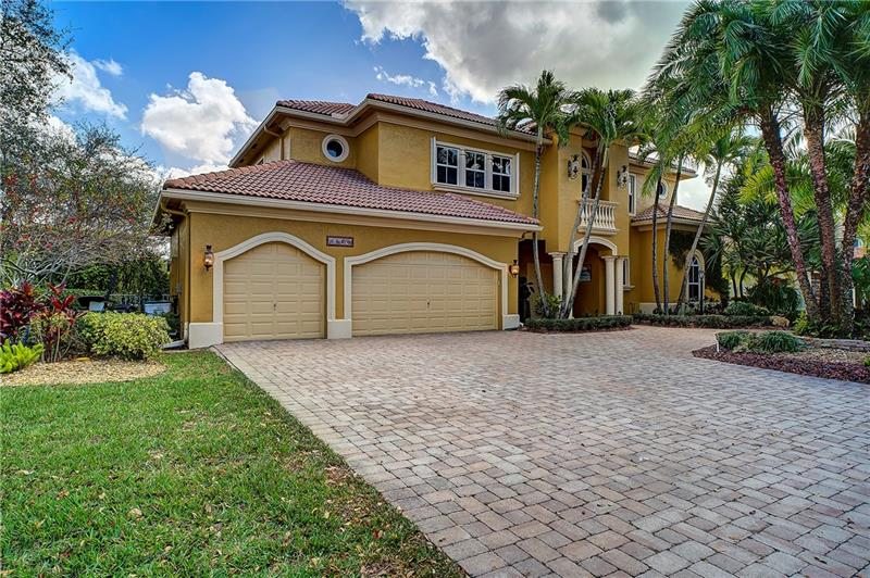 A stunning, custom 5/4.5 home in Parkland's prestigious Heron Bay community. The estate is set around a tranquil courtyard, large pool, and integrated spa. Adjacent to the courtyard is housed a richly decorated guest suite. The home opens to a formal living and dining room. The chef's kitchen features the finest appliances and granite countertops. The master suite, located on the ground floor, provides the utmost in luxury living.Upstairs includes three large bedrooms, extended-height ceilings, en-suite bathrooms, and loft space.The 3.5 car garage also includes a craftsman's shop.Additionally, the HVAC purification systems kill up to 99% of all bacteria, viruses, and mold.This home, dubbed 'Casa De Suenos' represents stately Florida living at its most refined, comfortable, and convenient.