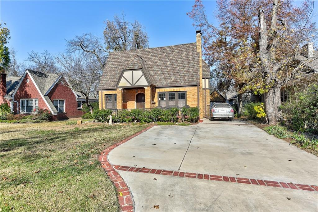 You will love this tudor charmer in one of Norman's most beloved historic districts. Located just steps from The Mont and the University of Oklahoma, it couldn't be better situated. The curb appeal, mature lot, and detached garage totally add to the charm! Stepping inside you will be drawn to the wood floors and gorgeous classic woodwork throughout. The fireplace makes the space feel so cozy, and period details like the arched doorways, wood shutters, french doors, and crown moulding just drip with historical charm. Updated in all the right places, this 1930 home is gorgeous ready for many more years to come.  Updates include: roof and gutters, leveling and floor joist reinforcement, insulation upgrade, and driveway in 2016; kitchen was remodeled in 2017; new back door 2020 and new paint in 2020. You will also love the screened in porch and the spacious fenced yard. If you have ever dreamed of owning a piece of Norman's history, this is such a beautiful opportunity!