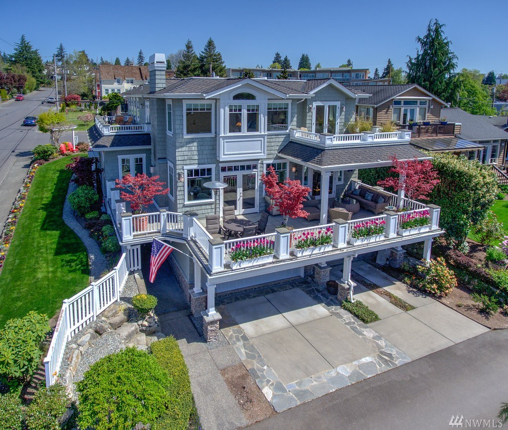 Elegant, Immaculate & Timeless. Perfect location: 1/2 block off Waverly Way & Heritage Park, 3 blocks to downtown Kirkland & waterfront. Soak up the SW views of Lake Washington, Olympic Mountains, and Seattle from any of the 3 view decks. Great floor plan includes a great room concept and open kitchen and a bathroom for every bedroom. Custom built wine celler.   Quality you won't find in most homes!   Enjoy outdoor living on the covered deck and experience West of Market living at its finest.