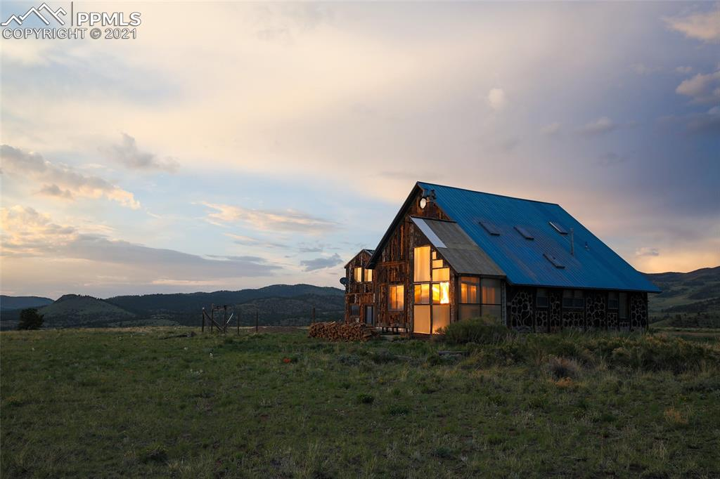 Your opportunity to make this artist home on 35 acres into your dream get-away! This off-grid home is powered by solar and comes complete with a welcoming second guest apartment. The mountain views from this home are jaw dropping! Heated by Wood Stoves, Propane and Passive Solar. Located in the RR Ranch (Double R Ranch) community with only 8 other properties, providing you with quick and easy community access to the National Forest.  Stepping into the charming main living space is warm and inviting. Unique artist touches add to the welcoming appeal of this mountain get-away.  Thinking self-sufficient homestead or small ranch? Chickens, Horses and personal-use live stock (except swine) are allowed! RV parking. Plenty of room to build your barn or green-house and have a self-sufficient homestead.  Astrotnomist and hobby star gazer dream property! This property is located between two mountain ranges in Westcliffe Colorado, a registered Internetional Dark Sky Community where the night sky views are protected from neighboring city light pollution. The night sky views from this home are world class SPECTACULAR!  Thinking VBRO?  This property is currently a VBRO short term vacation rental. Custer County is a VBRO friendly county. (Please inquire for available information.)  Please note that this home has additional construction needs. The main section of this house (Section A) and the apartment (Section C) are approximately 95% or more complete and move in ready, the remaining sections are in various states of repair and completion. Please see floor plan and agent notes for more information. 3D TOUR & FLOOR PLAN HAS BEEN PROVIDED FOR THIS LISTING. MOUNTAIN VIEWS - GOOD PRODUCING WELL (5.5 GALLONS PER MINUTE) - WORKSHOPS - LOTS OF ROOM TO EXPAND  Disclaimer: All statements believed to be accurate but must be verified by purchaser.