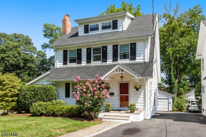 Welcome home to this delightful 5 bdr 3.1 ba home peacefully set back amidst mature pine trees & blooming perennials.Graced by pristine HW floors, lg architectural windows & a spacious LR w/wd burning FP & custom built-ins, this one checks all the boxes. A renovated open EIK w/ ss appliances, granite countertops, office nook & a seated island flows seamlessly to a sundrenched DR.  As a bonus, a fabulous SR/office off of the LR boasts views of the side, front and backyard. Upstairs features 4 sun-filled bdrs & 2 Ba including a private 3rd fl MBS w/ lg. WICs.  A finished walk out LL w/an add l bdr completes the interior. A flat lush backyard w/ a stone patio is perfect for backyard BBQ s & gatherings. Fantastic location steps from NYC trains, shopping, restaurants & top notch Millburn Schools.