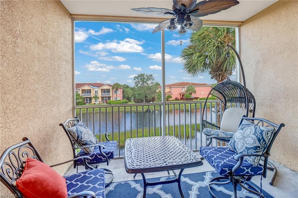 Top floor unit, situated in one of the most desirable buildings in the community. Offered optionally as turnkey furnished(see exclusions list in supplements if turnkey is desired) spanning nearly 1700 square feet under air this maintenance free home comes with an attached garage. Step out the hurricane impact sliders onto your expansive screened lanai with water views. Soaring high ceilings compliment the wood cabinets and granite kitchen equipped with a stainless steel appliance package. The owners suite is equipped with a large walk-in closet and en-suite bath featuring both a roman soaker tub and walk-in glass shower. This home needs to be seen to be appreciated. Ample guest parking right across the street. Villagio provides 24 hour man gated security and a premium amenity package with multiple swimming pools, tennis, fitness center, movie theater, ice cream bar, and full menu cafe open 7 days a week. All this and more with low HOA fees of only $390/mo - water, premium cable with DVR + Voice Remotes and high speed internet included!