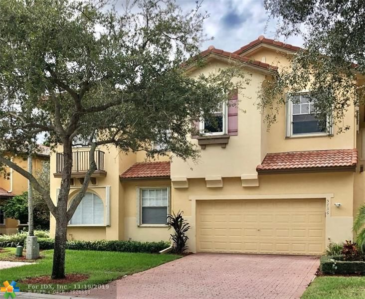 """Lakefront 2 Story Townhome with over 2300 AC. Sq FT, 3 Bedrooms, 2 1/2 Baths Plus 2 Car Garage with Oversized Driveway. The association with approval will allow you to fence the yard creating total privacy overlooking lake. House is being sold """"AS IS"""", looking for a family or investor  to Re-Model & call it their  home. House is handicapped equipped with a Acorn Lift/Stair lift which can be used or re-moved & donated. A.C 2 Years Old, Accordion Shutters throughout. Association takes care of all exterior including insurance, paint of exterior,Roof & Roof relacement, lawn care, monitored security, community pool. Enjoy the use of all of Heron Bays Resort Lifestlyle, Community Pools,Gyms, Play grounds, Tennis, Basketball & so much more. A+Schools"""