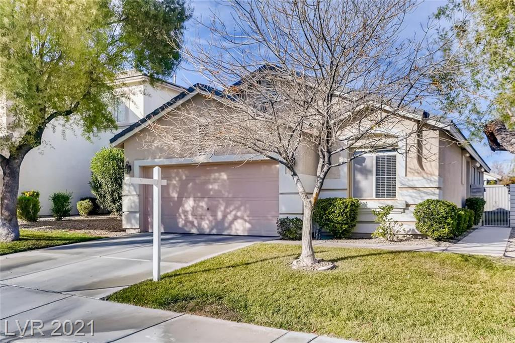 AMAZING SINGLE STORY HOUSE in Spring Mountain Ranch with several parks nearby! Shows like a model with HARDWOOD FLOORING, GRANITE COUNTERTOPS, NEW CARPET, ROLLADEN SHUTTERS, SOLAR SCREENS, CEILING FANS, PRIVATE YARD WITH COVERED PATIO, GRASS AND LARGE TREE, SEPARATE LAUNDRY ROOM WITH WASHER AND DRYER, SHELVING IN GARAGE. Freshly painted interior. Great location, close to shopping and freeway access.