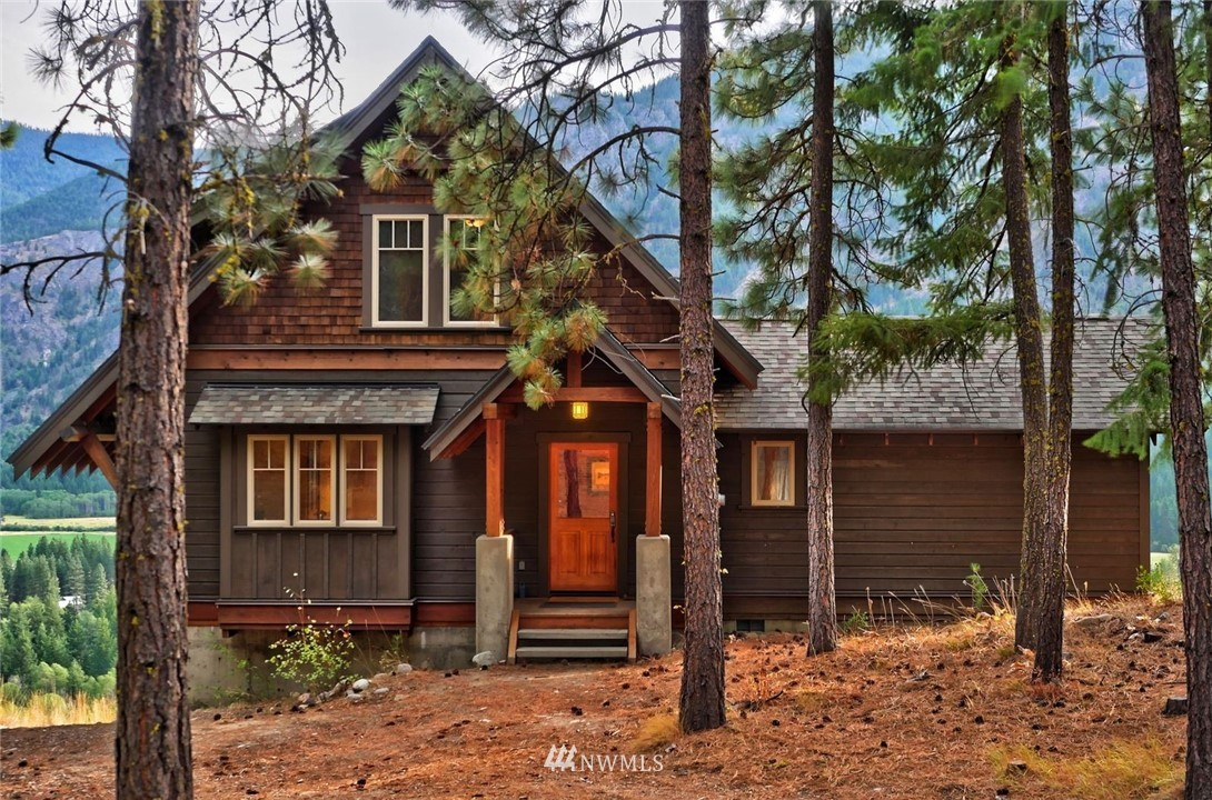 Contemporary home w sweeping 180 degree eagle's nest view in Mazama! Soak up the vista of several miles of lush riparian habitat & Methow River. Distinct design w concrete & wood entry.Thoughtful & efficient floorplan allows for multiple activities. Your toes will love the radiant heat bathroom flrs. Find peace & quiet on private view terrace off master. Beautiful woodwork & built-in bookcases. Lg unfinished basement rec rm/laundry is plumbed for 3rd bathroom. Inspiring views & close to trails!