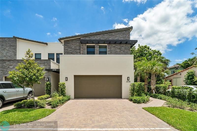 New Construction townhome in the heart of Fort Lauderdale.  This 2 story townhouse features 3 bedrooms and 2.5 baths as well as a loft and 2 car garage.  It was completed in July 2018 and has been impeccably maintained. The clean modern design carries from the exterior to the interior with a quality that is a notch above its competition. The Kitchen features a large island and is open to the living areas for seamless entertaining. The master is massive with a huge walk in closet and dual vanities in the bathroom. The paver patio is covered and is surrounded by landscaping and a 6 foot privacy fence.  Other bonuses include a hot tub and new bar that will be staying with the property.  This location is close to everything! Las Olas's fine dining & shops, beaches, airport, I-95, you name it!