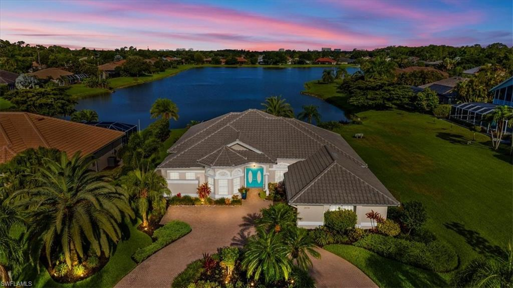 H2864 - Wonderful Lake front home with sunsets daily!  This updated pool home has long lake views.  High flat ceilings, tall sliders and tons of windows keep this home light & bright.  From the minute you walk in the view captivates you.  The open floor plan is perfect for families or entertaining.  The kitchen has a huge island with a pop up charging station and perfectly positioned cabinets.  Gorgeous granite has an upgraded leather finish sure to please.  Wonderful walk in pantry and lots of cabinets delights any cook.  The split bedroom plan has a guest wing that closes off for privacy.  Plantation shutters adorn many windows.  The den is perfect for an office or more guests.  All closets have custom organizers and the storage is great!  Outside the salt water pool has been resurfaced, a new pool cage with picture window screen was added in 2014.  The pool deck was done in travertine. Wonderful location, great schools & restaurants close by.  Close to the beach too.  Close to rear gate to livingston road.  Imperial Golf Club is optional with several membership choices if desired.