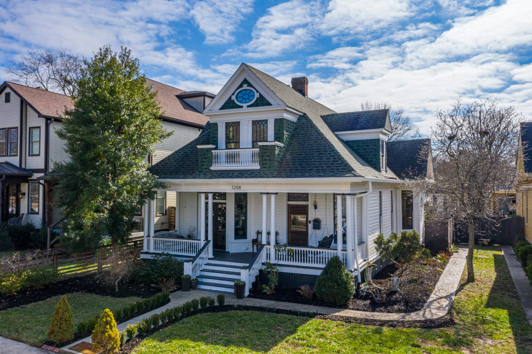Historical Victorian artistically renovated beauty on sought-after Gartland Avenue in East Nashville. Second Floor is a private master suite with vaulted ceilings, study, fireplace and gorgeous master bath. Backyard is a botanical garden complete with Koi pond and outdoor dining under the pergola!  Kitchen renovation includes an Italian live gas stove, custom copper hood and walnut, zinc and marble countertops. Upgrade list is extensive!!  Plus just a short walk to 5 Points!
