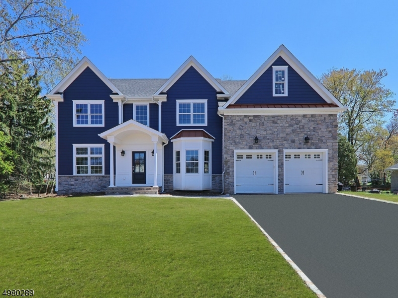 New construction! Beautiful lot! Features: 51/2 baths; full bsmt with high cielings; fin rec rm and bath. 2 Sty Ent Foyer; Kit quartz tops; ss JenAir appliances and farm sink, wine rack; Gas FPL (fam rm); MBedroom 2 Lg wi closets, Lg Master Bath with soaking tub, shower w/bench, high cieling. Other fine features:Hardwood floors throughout (dark stain);many recessed lights, crown moldings on first floor(except bedroom); hardiplank siding; 2 staircases; picture frame woodwork; paver patio; upgraded closets. Hugh Walk-up attic ready to finish. Slightly over .5 mile to NYC Train, Bus, and Downtown shopping.