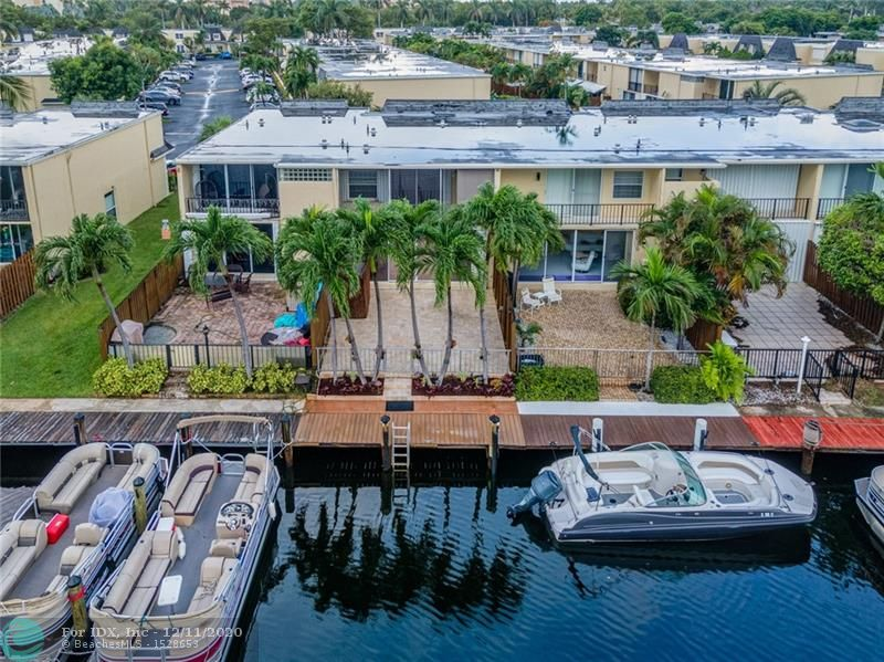 Spectacular Waterfront Townhouse that has private boat dock attached.  Direct canal access to the Intracoastal that connects out to the Ocean.  Private dock for a boat up to 28 ft with premium Trex decking that will not fade.  Watch the sunrise from your master bedroom screened balcony or courtyard patio that is perfect for entertaining.  Updated interior that has been freshly painted, brand new carpet, and newer full size washer & dryer.  All sliders have mirrored tent & remote control electric shades, all windows have matching upgraded Hunter Douglas silhouette shades, and all window coverings have accordion hurricane shutters.  Excellent floorplan with large master suite.  Highly desired community with pool, tennis courts, pet friendly, & more.  Watch the Virtual Tour!