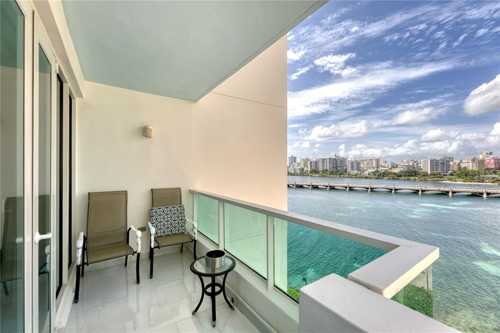 Oceanfront apartment with awe inspiring ocean and lagoon views, conveniently located between Paseo Caribe and the Caribe Hilton hotel. Condado Lagoon Villas offers 24-hr lobby attendant, valet parking, swimming pool and a full power generator. The unit features two bedrooms, three full baths and one parking space.   Steps from world-class dining and entertainment at Paseo Caribe and the Caribe Hilton Hotel. Minutes from Old San Juan and Condado. Nestled in a vibrant community which integrates luxury condominiums, shops, restaurants, entertainment, beaches and the waterfront promenade overlooking historic Fort San Geronimo, Condado Lagoon, and the Atlantic Ocean.  The residence is also available to lease for $9,000 per month.  Annual Hazard Insurance: $2,780.  Monthly Condo Fee: $1,787.