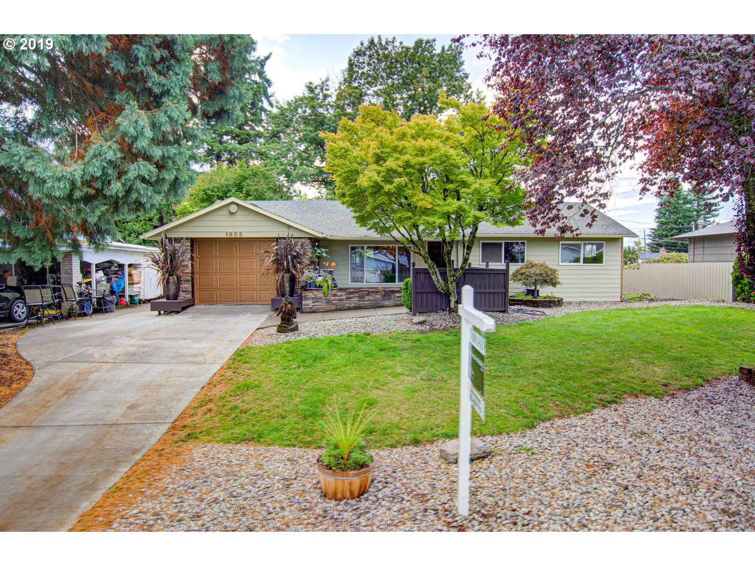 Incredible opportunity in SE Portland. Spacious Mill Park home with finished basement on a 0.22 Acre double lot. Thoroughly remodeled with exceptional attention to detail. Updated kitchen and bathroom as well as artistic stonework and finish carpentry. 3 bedrooms and full bath on the main floor and master suite in the finished basement. Expansive back deck and large private back yard.  Open Houses Fri 5-7pm, Sat 2-4pm, Sun 12-2pm