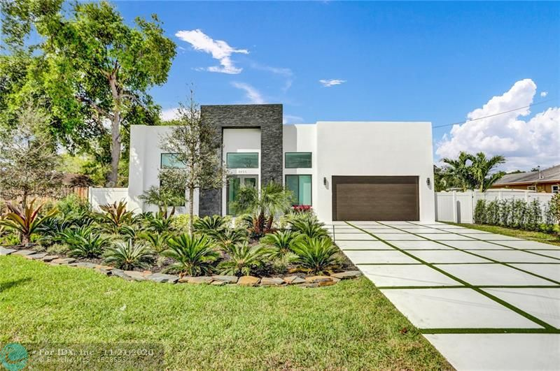 Stunning Brand NEW Home. Ultra Modern 4 Bedroom / 3 bath home features an open concept with split bedrooms, 13 Ft ceilings with all impact windows, marble floors, 2 car garage, in-ground pool on deep water with ocean access. Contemporary finishes with all high-end materials, fixtures, and appliances. A hidden gem in Dania/Fort Lauderdale.  in the kitchen with a smart fridge and other smart home options included.