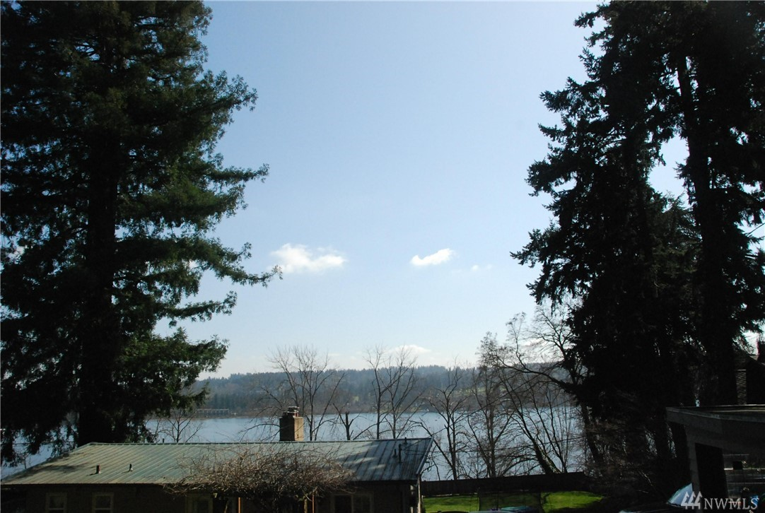 Great opportunity to rebuild or upgrade to a new home on this  huge private 180 degree Lake Washington view lot. Located in the fast growing Lake Forest Park area. This 0.58 acre lot has many potentials. Just minutes walk to Third Place Books, Honey Bear Bakery, Burke-Gilman Trail and the lake. Deeded access to Lake Forest Park Civic  beach club and boat launch. Alley Access available.This home has all utility hook-ups. Home is in need of  renovation / rehab and is being sold as is.