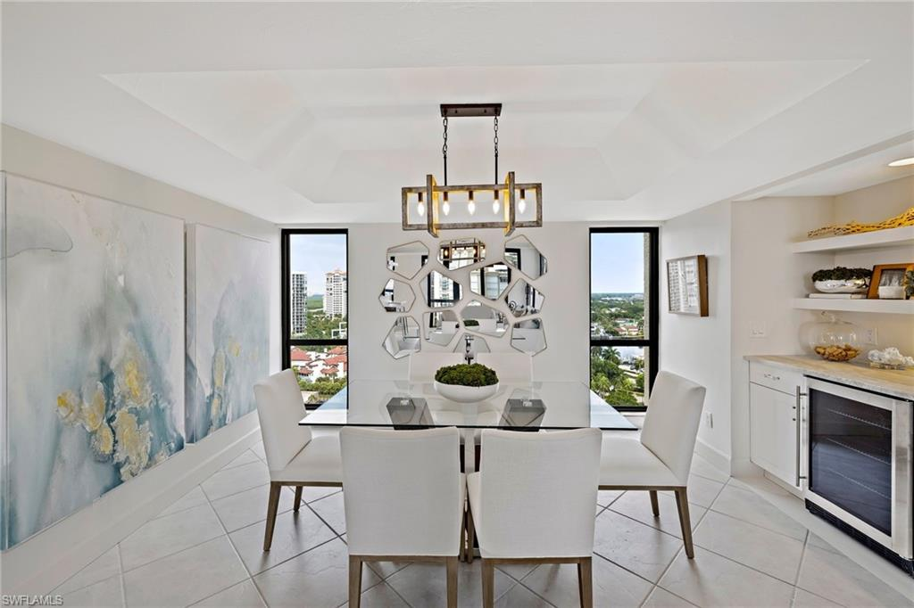 Spectacular Gulf to Bay views, this Park Shore condo enjoys sunny Southwestern exposure & turquoise water views that will take your breath away. Thoughtfully & tastefully remodeled throughout, including kitchen remode by BCB Homes with Cristallo Quartzite countertops, Mother of Pearl shell tile backsplash, wine fridge, & high-end appliances. Custom updates include remote-controlled Hunter Douglas blinds, new light fixtures & sconces, custom millwork, kitchen banquette, new A/C, new washer/dryer & freshly painted interior. Enjoy all the Esplanade Club beachfront living has to offer, including resort-style pool & spa, outdoor fireplace, grills, covered cabana with wet bar, sunset deck, and a quiet stretch of gorgeous white sand beach. Just a short walk to Venetian Village shops & dining, the Esplanade Club provides a pet-friendly building with impact windows & doors, covered, deeded parking, car wash, 24-hour security, remodeled social room/catering kitchen, & peace of mind with a well-run, fiscally responsible building. Boat slips on the Bay are also available for lease or purchase from the Venetian Bay Yacht Club. Something for everyone!