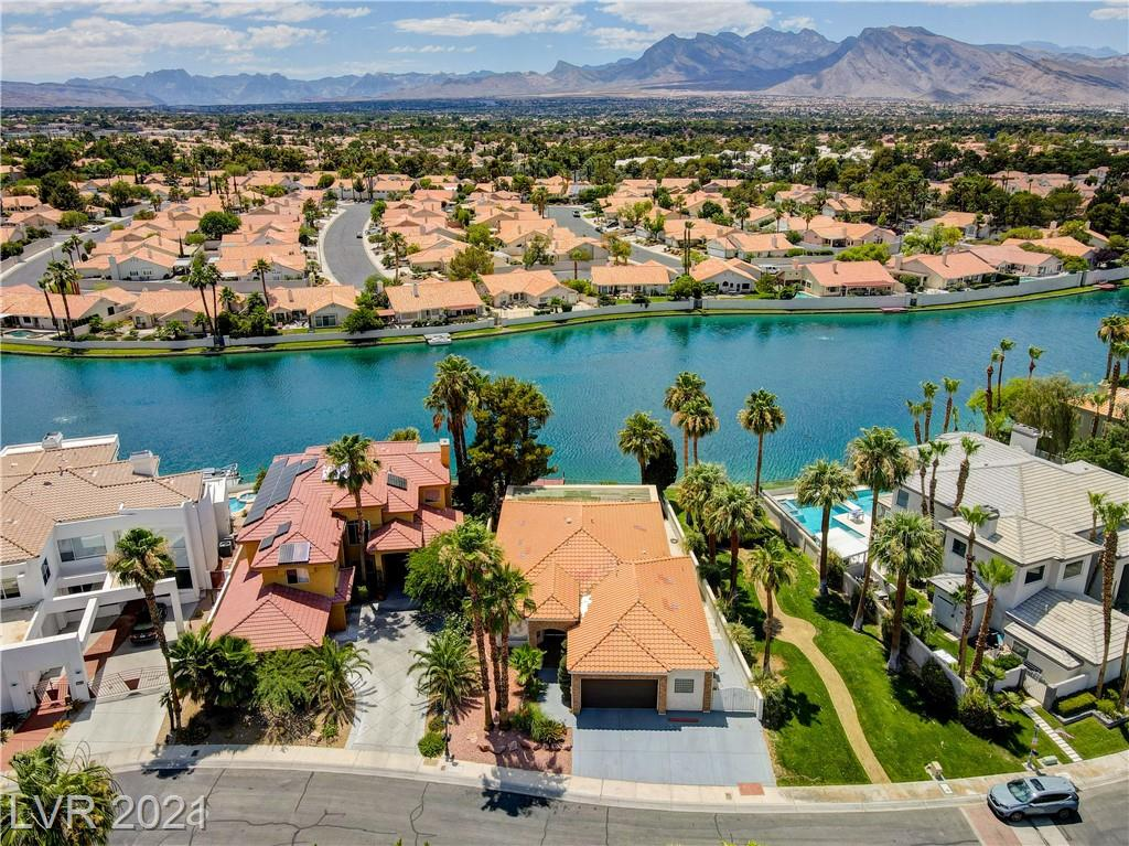 Stunning WATERFRONT single-story custom home in spectacular gated Ritz Cove, in Desert Shores.  The community features four man-made lakes, a lagoon-style swimming pool surrounded by a sand beach, palm trees, and a picnic park with playground facilities.  The only single-story fronting the lake in Ritz Cove. Live security guard at night.  Beautiful 3 bedrooms 2 full bathrooms.  Large kitchen with granite countertops and skylight.   Living room and master bedroom have gorgeous views of the lake.  Huge master bedroom with attached bathroom with walk-in shower and jetted tub with a big walk-in closet.  Tiles throughout the house except for carpet in the bedrooms.   Ceiling fans in all bedrooms and the living room. 2 car attached garage with a bonus room in the garage.  Private boat deck. Desert landscaping front yard, green grass in the back yard.   *** PLEASE WEAR BOOTIES OR REMOVE SHOES INSIDE HOME***