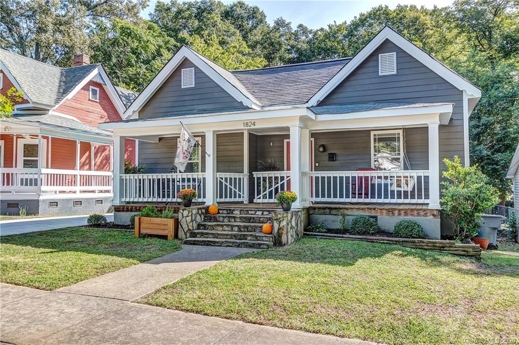Originally built in the early 1900s but totally renovated in 08-09, this adorable craftsman in Villa Heights has today's conveniences in a historic home.  Upon entry from the covered front porch, hardwood floors and high ceilings accent the main living room area which features a beautiful mantle and gas fireplace. Down the hallway is the large kitchen which is open to the dining area. The kitchen features granite countertops & huge cabinets. The primary bedroom is complimented with an ensuite featuring a glassdoor encased tub with marble tile and a walk-in closet. This home has two additional bedrooms and a full bath. In 2019, the sellers added on the huge (almost 400 sq ft) sunroom, which is fully insulated but not currently heated. This room provides a whole other living space to this house and has a large deck overlooking the backyard. Walking distance to Midwood, NoDa and the Parkwood Light Rail stop, along with great VH businesses like the Hobbyist and Rhino,this home has it all.